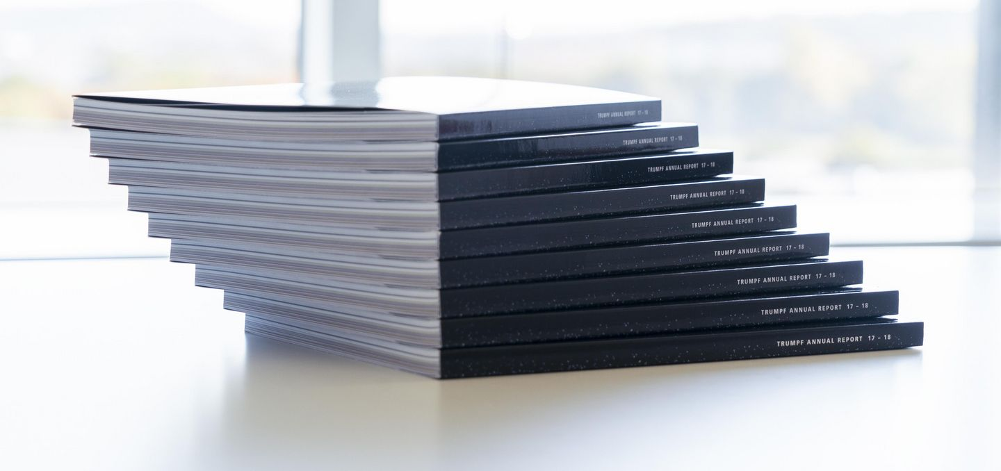 A stack of TRUMPF annual reports