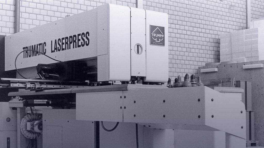 historical picture showing a combined punching and laser-cutting machine of TRUMPF